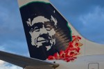Famous Native Alaskan on Alaska Airlines planes wears a lei in honor of the new Hawaii flights.
