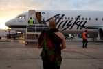 Aukai La'amaikahiki performs a traditional Hawaiian blessing for the inaugural Alaska Airlines flight from Bellingham to Honolulu.