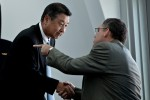 ANA senior executive vice president Mitsuo Morimoto shakes hands with Scott Francher, Boeing's VP of the 787 program.