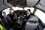 ANA flight attendants Kyoko Kouokawa, left, and Maki Sakatani, right, remark at the spaciousness of the new flight deck.