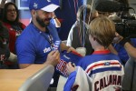 A young fan wins an autographed Marian Gaborik jersey. (Photo by Matt Molnar/NYCAviation)