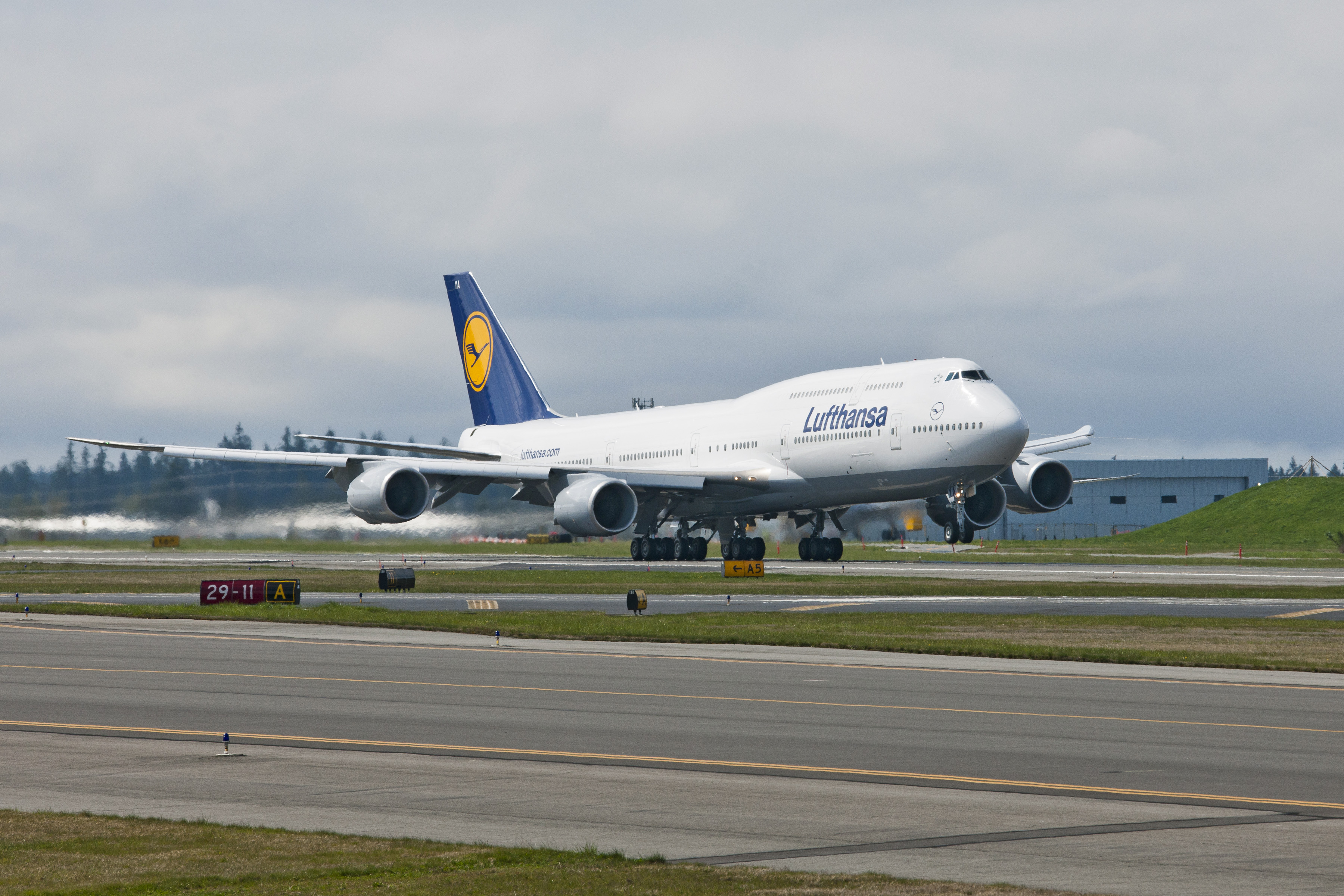 Lufthansa 747-8I takes off on a test flight. (Photo by Boeing)