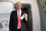 Lufthansa Senior Vice President Nico Bucholz poses with his boarding pass.