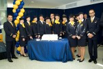 Crew of the first Lufthansa Boeing 747-8I revenue flight pose with a cake. (Photo by Cary Liao/NYCAviation)