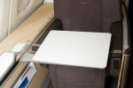 First Class seat with tray table. (Photo by Eric Dunetz/NYCAviation)