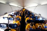Southwest employees, family members, and media guests seat themselves prior to the flight.