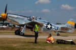 The Brat III taxies back to th warbird ramp as a volunteer tends to a ramper who took a spill off her scooter.
