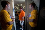 Brooks Thomas, communications employee with Southwest Airlines, welcomes a visitor on board the newly revamped 737-700.