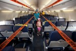 A family tours the new Evolve interior of the Southwest 737-700 at AirVenture 2012.