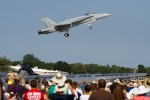 The F/A 18 performs a go-around in front of the crowd.