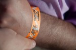 NYCA editor-in-chief Matt Molnar affixes his 2012 Oshkosh AirVenture admission band to his wrist.