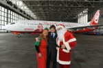 Santa Claus and his helpers pose in front of the Air Berlin Santa Claus Tour 2012 Boeing 737 (D-ABMJ). (Photo by Air Berlin)
