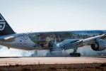 Air New Zealand's Boeing 777-300 ER fully wrapped Hobbit plane touches down at Los Angeles International Airport on Saturday, November 24, 2012, in Los Angeles. (Photo by Bret Hartman/For Air New Zealand)