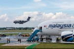 Airbus A400M Atlas landing behind the Malaysia Airlines A380. (Photo by Airbus)