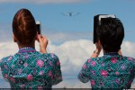 Malaysia Airlines cabin crew members take photos of the company's no. 2 A380 during its flying display at the 2012 Farnborough International Airshow. (Photo by Airbus)