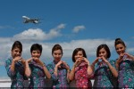 Cabin crew members for Malaysia Airlines show their love for the 21st century flagship A380 at the 2012 Farnborough Airshow. (Photo by Airbus)