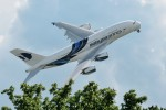 Malaysia Airlines Airbus A380 soars over a tree. (Photo by tobyjim via Flickr, CC BY-NC-SA)