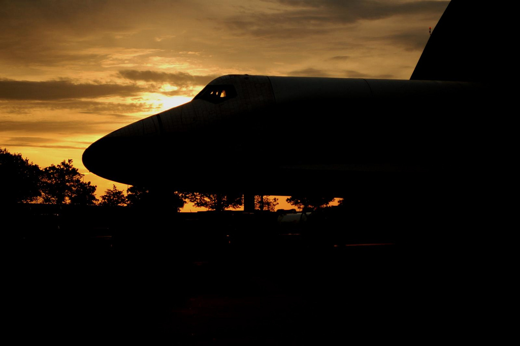 Space Shuttle Enterprise is pushed back into Hangar 12 at daybreak. (Photo by Guy Dickinson, CC BY-SA)