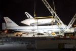 NASA and United Space Alliance technicians prepare to demate Space Shuttle Enterprise from the NASA Shuttle Carrier Aircraft. (Photo by Eric Dunetz)