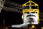 Head-on half view of Space Shuttle Enterprise being raised. (Photo by Eric Dunetz)