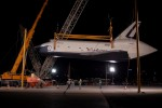 Space Shuttle Enterprise is held by two cranes after being demated from the Shuttle Carrier Aircraft. (Photo by Guy Dickinson, CC BY-SA)