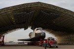 The space shuttle Enterprise, mounted on transport vehicle, is backed into a temporary hanger after being demated from the NASA 747 Shuttle Carrier Aircraft (SCA) at John F. Kennedy (JFK) International Airport on Sunday, May 13, 2012. (Photo by NASA/Kim Shiflet)