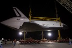 The Space Shuttle Enterprise hangs from a sling after being demated from the NASA 747 Shuttle Carrier Aircraft. (Photo by NASA/Kim Shiflet)