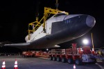The Space Shuttle Enterprise is lowered onto a transport vehicle after being demated from the NASA 747 Shuttle Carrier Aircraft. (Photo by NASA/Kim Shiflet)