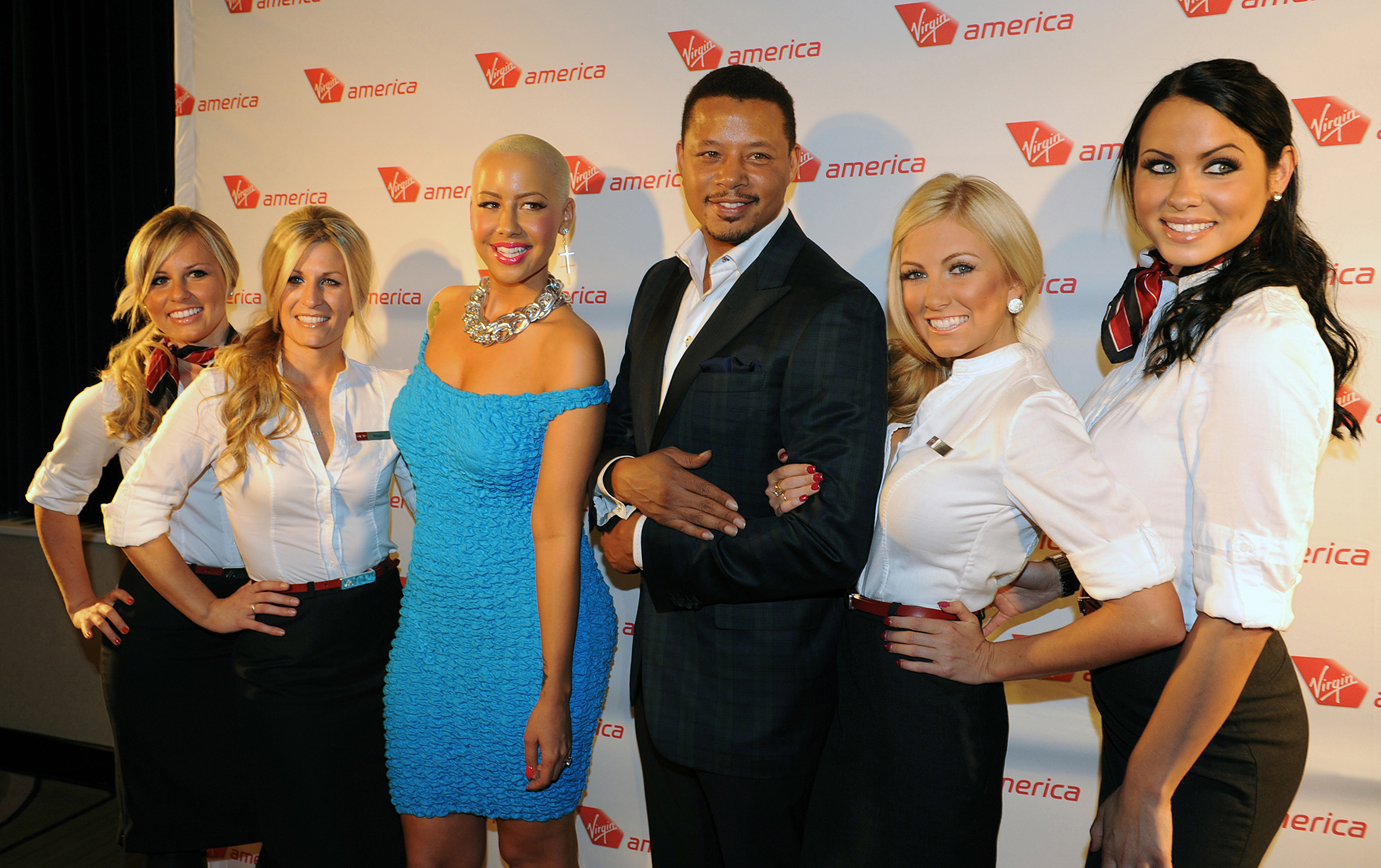 Terrence Howard and Amber Rose pose on the red carpet with Virgin America in-flight teammates at the Philadelphia hotspot, Hotel Palomar, to celebrate arrival of Virgin America\'s Inaugural Flight. (Bloomberg Photo/Virgin America Airlines, Bob Riha, Jr.)