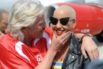 Sir Richard Branson and Amber Rose share a moment on the tarmac. (Photo by Manny Gonzalez/NYCAviation)