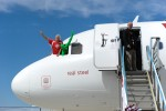 Sir Richard Branson and Green Man poke their head out of the plane.