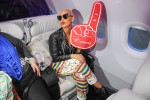Amber Rose wears her Virgin America foam finger. (Photo by Manny Gonzalez/NYCAviation)