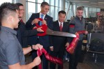 President Obama (Reggie Brown) cutting the ribbon at the departure date.