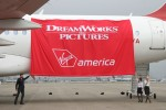 Jackman and Virgin America in-flight teammates prepare to reveal the Airbus A320 &lt;em&gt;Real Steel&lt;/em&gt;'s new artwork at Los Angeles International Airport. (Photo by Stephen Shrank)