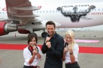 <em>Real Steel</em> star Hugh Jackman and Virgin America in-flight teammates show off their boxing stance after revealing Virgin America's new A320 <em>Real Steel</em>. (Photo by Stephen Shrank)