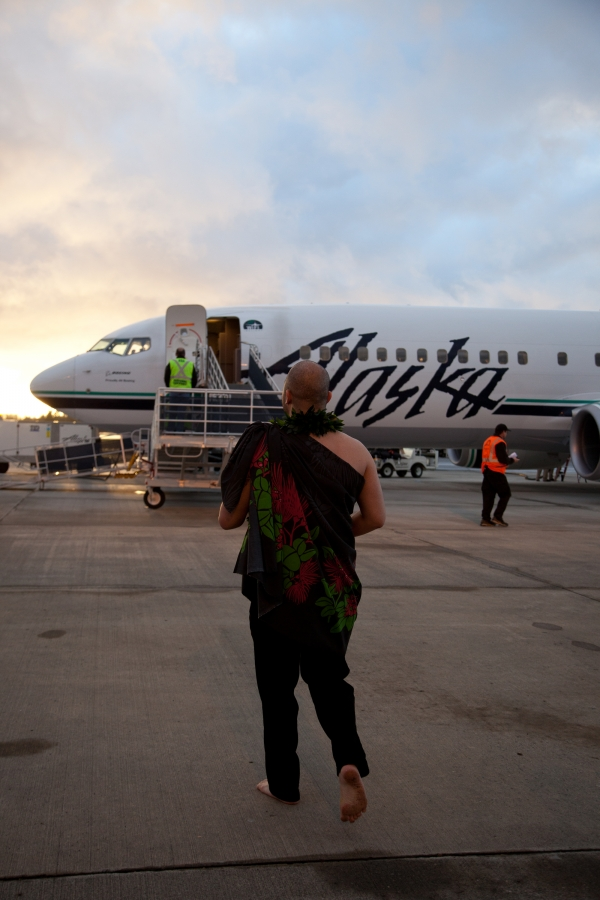 Aukai La\'amaikahiki performs a traditional Hawaiian blessing for the inaugural Alaska Airlines flight from Bellingham to Honolulu.
