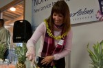 Lisa Luchau , Director, On Board Food and Beverage at Alaska Airlines greets guest with a few pre-flight refreshments and yes, pineapple was served.