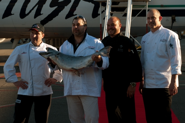 Chefs pose with the salmon. (Photo by Tad Carlson)