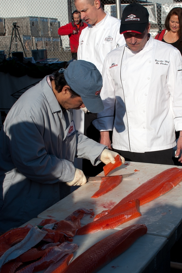 Fileting the salmon. (Photo by Tad Carlson)