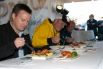 Judges eating the fish. (Photo by Tad Carlson)