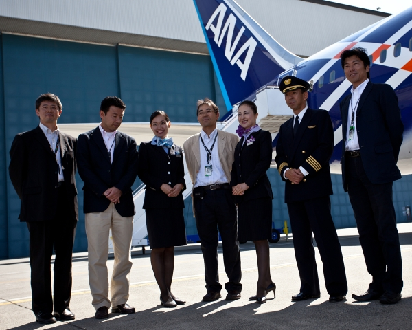 ANA staff pose in front of the new plane.