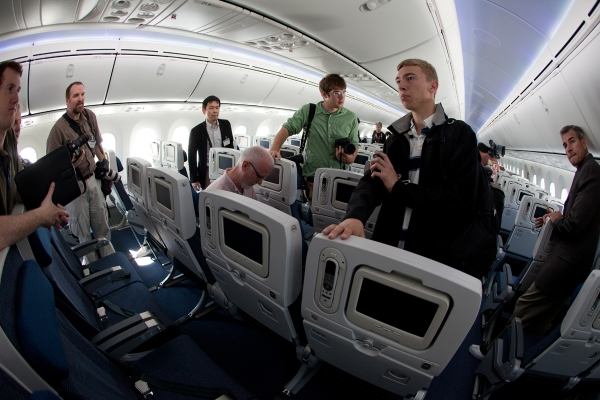 Reporters quiz Boeing staff in the economy section.