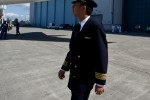 ANA pilot Yoshio Taneda performs a walk around of the new aircraft.