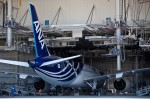 The first Boeing 787 to be delivered is towed out of the paint hangar.