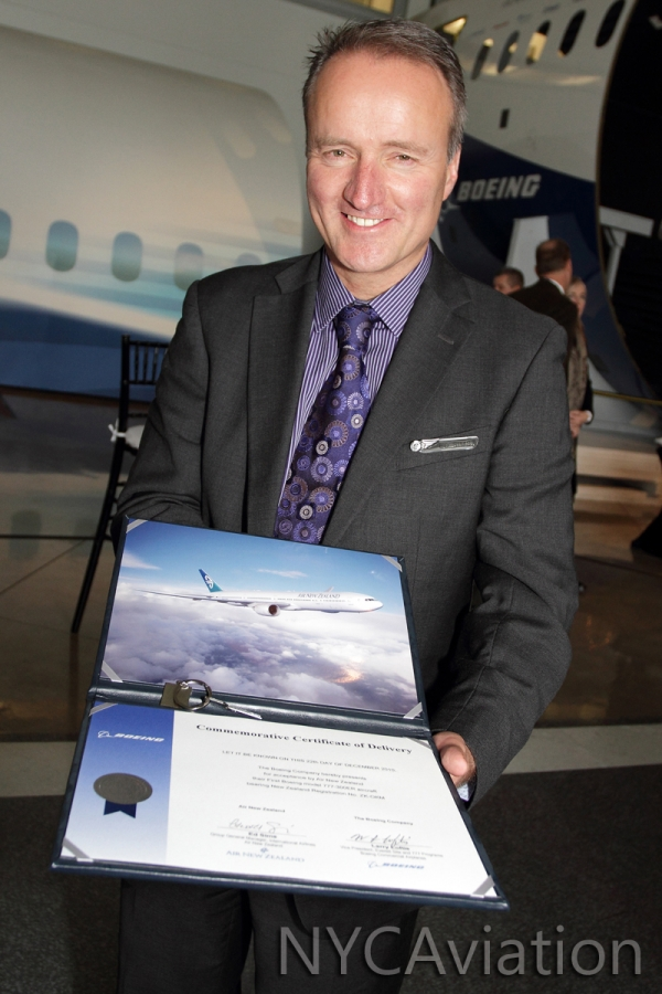 Ed Sims with keys and certificate to the plane