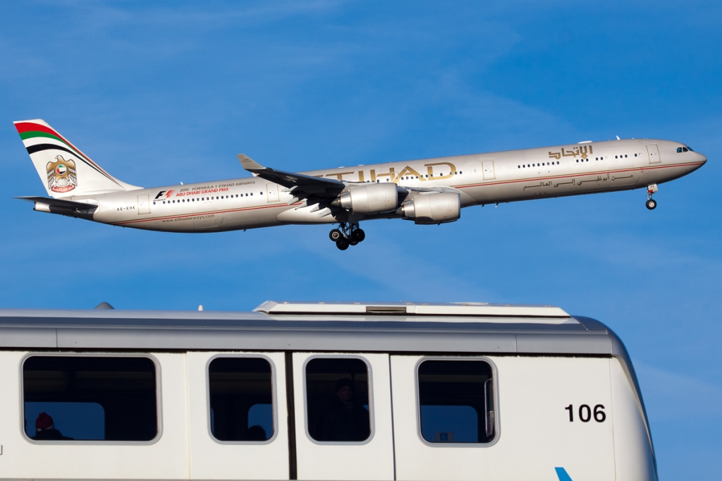 An Etihad A340-600 by a nose! Passing a JFK AirTrain. (Photo by Nick Peterman)