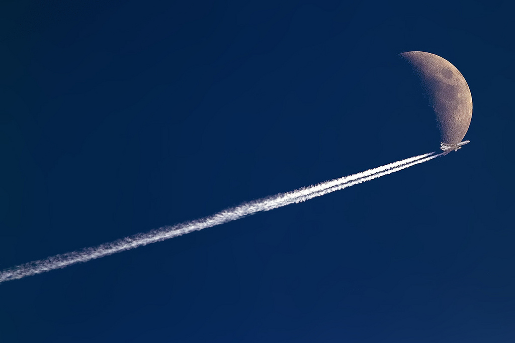 An a World MD-11 jumped over the moon. (Photo by Nick Peterman)