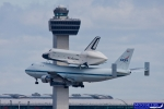 Space Shuttle Enterprise passes JFK Tower. (Photo by John Musolino)