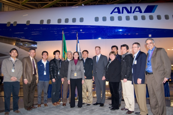 Kim Pastega with representatives of ANA in front of the plane.