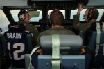 On the flight deck with a Tom Brady jersey. (Photo by US Air Force/SrA. Kelly Galloway)